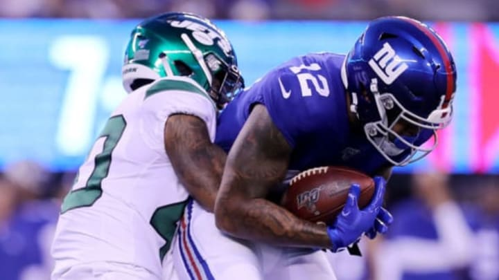 EAST RUTHERFORD, NEW JERSEY – AUGUST 08: Cody Latimer #12 of the New York Giants makes the catch as Kyron Brown #40 of the New York Jets defends in the first quarter during a preseason matchup at MetLife Stadium on August 08, 2019 in East Rutherford, New Jersey. New York Jets (Photo by Elsa/Getty Images)