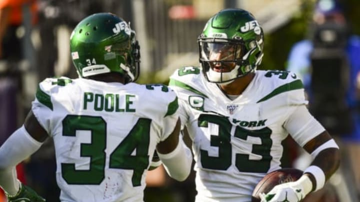 FOXBOROUGH, MA – SEPTEMBER 22: Jamal Adams #33 of the New York Jets reacts with Brian Poole #34 after scoring a touchdown after an interception during the fourth quarter of a game against the New England Patriots at Gillette Stadium on September 22, 2019 in Foxborough, Massachusetts. New York Jets (Photo by Billie Weiss/Getty Images)