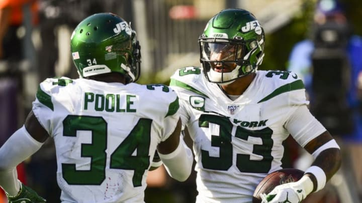 FOXBOROUGH, MA - SEPTEMBER 22: Jamal Adams #33 of the New York Jets reacts with Brian Poole #34 after scoring a touchdown after an interception during the fourth quarter of a game against the New England Patriots at Gillette Stadium on September 22, 2019 in Foxborough, Massachusetts. (Photo by Billie Weiss/Getty Images)