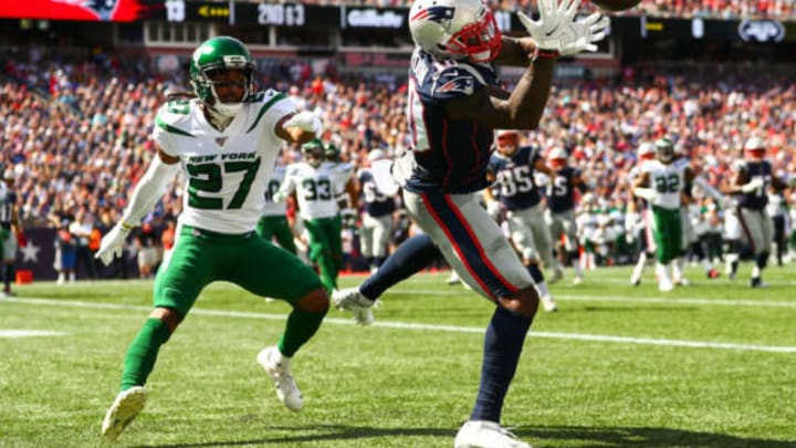 FOXBOROUGH, MA – SEPTEMBER 22: Josh Gordon #10 of the New England Patriots bobbles a throw from Tom Brady #12 of the New England Patriots while under pressure from Darryl Roberts #27 of the New York Jets during a game at Gillette Stadium on September 22, 2019 in Foxborough, Massachusetts. New York Jets (Photo by Adam Glanzman/Getty Images)