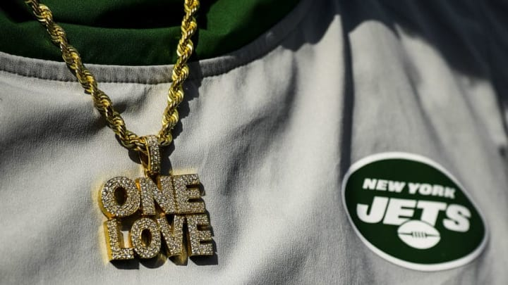 FOXBOROUGH, MA - SEPTEMBER 22: A necklace on a member of the New York Jets is displayed during a game against the New England Patriots at Gillette Stadium on September 22, 2019 in Foxborough, Massachusetts. (Photo by Billie Weiss/Getty Images)