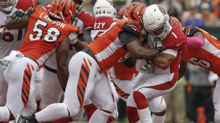 CINCINNATI, OH - OCTOBER 06: Geno Atkins #97 of the Cincinnati Bengals makes a hit on Kyler Murray #1 of the Arizona Cardinals during the first half that resulted in a roughing the quarterback penalty at Paul Brown Stadium on October 6, 2019 in Cincinnati, Ohio. (Photo by Michael Hickey/Getty Images)
