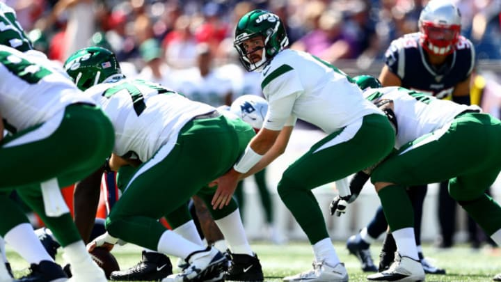 FOXBOROUGH, MASSACHUSETTS - SEPTEMBER 22: Luke Falk #8 of the New York Jets hikes the ball against the New England Patriots during the first quarter in the game at Gillette Stadium on September 22, 2019 in Foxborough, Massachusetts. (Photo by Adam Glanzman/Getty Images)