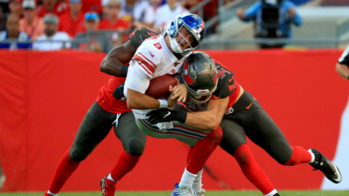 TAMPA, FLORIDA - SEPTEMBER 22: Daniel Jones #8 of the New York Giants is hit by Carl Nassib #94 of the Tampa Bay Buccaneers during a game at Raymond James Stadium on September 22, 2019 in Tampa, Florida. (Photo by Mike Ehrmann/Getty Images)