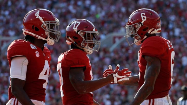 TUSCALOOSA, ALABAMA - SEPTEMBER 28: DeVonta Smith #6 of the Alabama Crimson Tide reacts after scoring a touchdown against the Mississippi Rebels with Jerry Jeudy #4 and Jaylen Waddle #17 at Bryant-Denny Stadium on September 28, 2019 in Tuscaloosa, Alabama. (Photo by Kevin C. Cox/Getty Images)
