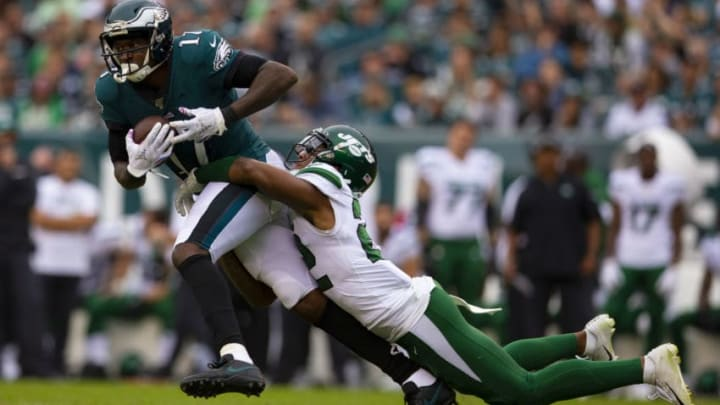 PHILADELPHIA, PA - OCTOBER 06: Alshon Jeffery #17 of the Philadelphia Eagles catches a pass and is tackled by Trumaine Johnson #22 of the New York Jets in the second half at Lincoln Financial Field on October 6, 2019 in Philadelphia, Pennsylvania. The Eagles defeated the Jets 31-6. (Photo by Mitchell Leff/Getty Images)