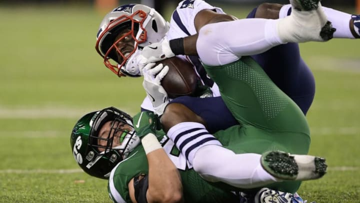 EAST RUTHERFORD, NEW JERSEY - OCTOBER 21: Benjamin Watson #84 of the New England Patriots makes a first down catch against Blake Cashman #53 of the New York Jets during the first half at MetLife Stadium on October 21, 2019 in East Rutherford, New Jersey. (Photo by Steven Ryan/Getty Images)
