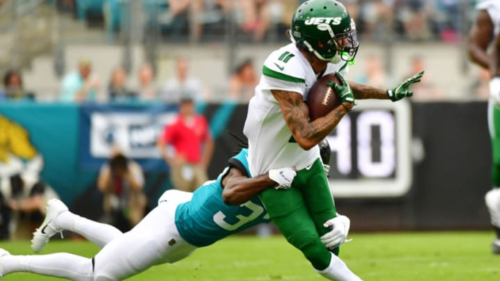 JACKSONVILLE, FLORIDA - OCTOBER 27: Robby Anderson #11 of the New York Jets gets tackled by Tre Herndon #37 of the Jacksonville Jaguars in the first quarter of a football game at TIAA Bank Field on October 27, 2019 in Jacksonville, Florida. (Photo by Julio Aguilar/Getty Images)