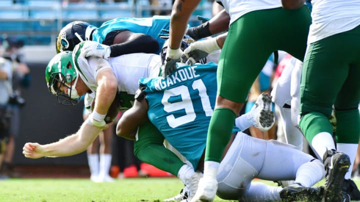 JACKSONVILLE, FLORIDA - OCTOBER 27: Sam Darnold #14 of the New York Jets gets sacked by Yannick Ngakoue #91 of the Jacksonville Jaguars in the third quarter of a football game at TIAA Bank Field on October 27, 2019 in Jacksonville, Florida. (Photo by Julio Aguilar/Getty Images)