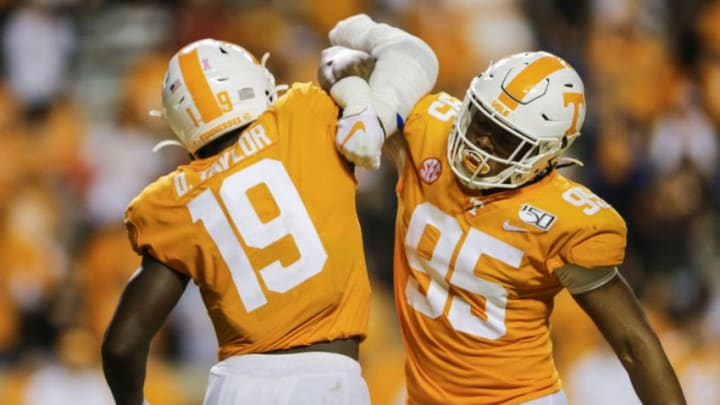 KNOXVILLE, TENNESSEE - OCTOBER 26: Darrell Taylor #19 of the Tennessee Volunteers celebrates stopping the South Carolina Gamecocks from making a first down with Kivon Bennett #95 at Neyland Stadium on October 26, 2019 in Knoxville, Tennessee. (Photo by Silas Walker/Getty Images)