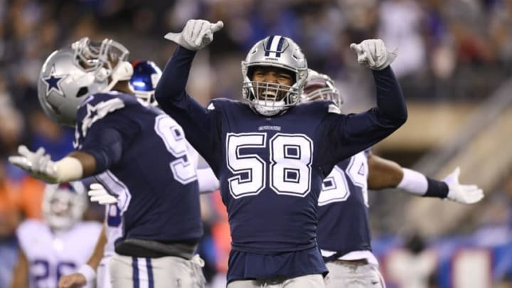 EAST RUTHERFORD, NEW JERSEY - NOVEMBER 04: Robert Quinn #58 of the Dallas Cowboys reacts with teammates Demarcus Lawrence #90 and Jaylon Smith #54 after Lawrence sacks Daniel Jones #8 (NOT IN FRAME) of the New York Giants (not pictured) during the first quarter of the game at MetLife Stadium on November 04, 2019 in East Rutherford, New Jersey. (Photo by Sarah Stier/Getty Images)