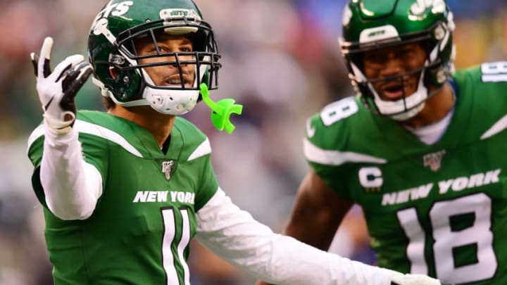 EAST RUTHERFORD, NEW JERSEY - NOVEMBER 24: Robby Anderson #11 and Demaryius Thomas #18 of the New York Jets react during the second half of their game against the Oakland Raiders at MetLife Stadium on November 24, 2019 in East Rutherford, New Jersey. (Photo by Emilee Chinn/Getty Images)