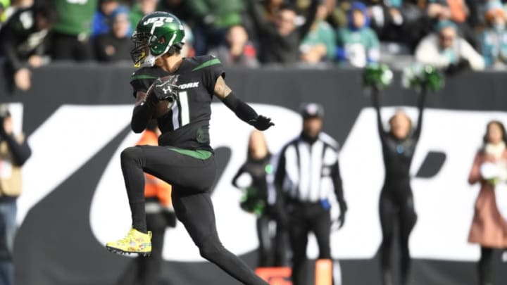 EAST RUTHERFORD, NEW JERSEY - DECEMBER 08: Robby Anderson #11 of the New York Jets runs the ball into the end zone for a touchdown during the first half of the game against the Miami Dolphins at MetLife Stadium on December 08, 2019 in East Rutherford, New Jersey. (Photo by Sarah Stier/Getty Images)