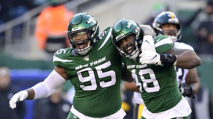 EAST RUTHERFORD, NEW JERSEY - DECEMBER 22: Quinnen Williams #95 and Jordan Jenkins #48 of the New York Jets celebrates against the Pittsburgh Steelers at MetLife Stadium on December 22, 2019 in East Rutherford, New Jersey. (Photo by Steven Ryan/Getty Images)
