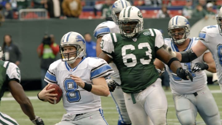 Detroit Lions #8 quarterback Jon Kitna scrambling to get away from New York Jets # 63 Dewayne Robertson during the Detroit Lions vs New York Jets game on October 22, 2006 The Meadowlands , East Rutherford, New Jersey Jets' 31-24 win over the Detroit Lions (Photo by Tom Berg/NFLPhotoLibrary)