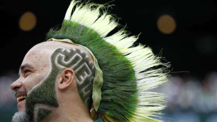 EAST RUTHERFORD, NJ - SEPTEMBER 18: A fan of the New York Jets looks on during a game against the Jacksonville Jaguars at MetLife Stadium on September 18, 2011 in East Rutherford, New Jersey. (Photo by Jeff Zelevansky/Getty Images)