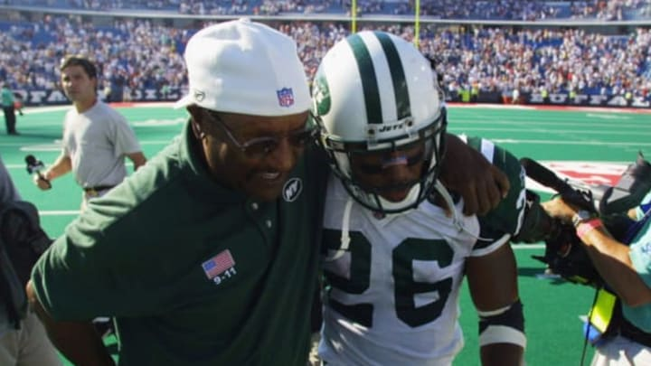 ORCHARD PARK, NY – SEPTEMBER 8: Running back Chad Morton #26 of the New York Jets walks off the field with a coach after his kickoff return abruptly ended the NFL game against the Buffalo Bills on September 8, 2002 at Ralph Wilson Stadium in Orchard Park, New York. The Jets won in overtime 37-31. (Photo by Rick Stewart/Getty Images)