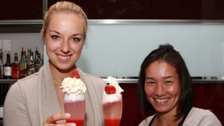 BIRMINGHAM, ENGLAND – JUNE 11: Sabine Lisicki of Germany and Kimiko Date-Krumm of Japan take part in a mocktail making session during day one of the AEGON Classic at Edgbaston Priory Club on June 11, 2012 in Birmingham, England. (Photo by Jan Kruger/Getty Images)