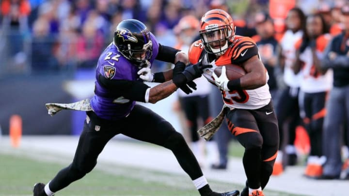BALTIMORE, MD - NOVEMBER 10: Cornerback Jimmy Smith #22 of the Baltimore Ravens tackles running back Gio Bernard #25 of the Cincinnati Bengals during the second half at M&T Bank Stadium on November 10, 2013 in Baltimore, Maryland. (Photo by Rob Carr/Getty Images)