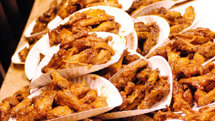 PHILADELPHIA - JANUARY 30: Buffalo Wings are stacked up before the competition begins at the 12th Annual Wing Bowl on January 30, 2004 in Philadelphia, Pennsylvania. Over 15,000 fans arrived at 6 a.m. to attend the 12th annual Wing Bowl sponsored by WIP Sports Radio 610. (Photo by Jeff Fusco/Getty Images)
