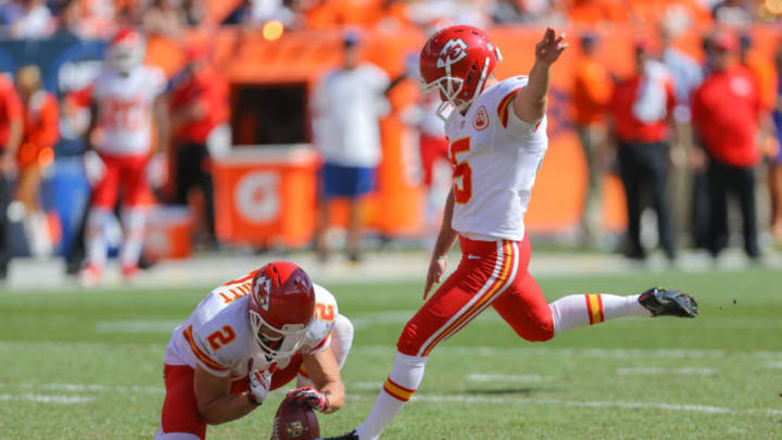 DENVER, CO - SEPTEMBER 14: Kicker Cairo Santos #5 of the Kansas City Chiefs kicks a 45 yard first quarter field goal as punter Dustin Colquitt #2 holds against the Denver Broncos during a game at Sports Authority Field at Mile High on September 14, 2014 in Denver, Colorado. (Photo by Justin Edmonds/Getty Images)