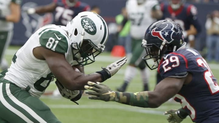 HOUSTON, TX - NOVEMBER 22: Quincy Enunwa #81 of the New York Jets runs after the catch and challenges Andre Hal #29 of the Houston Texans in the second quarter on November 22, 2015 at NRG Stadium in Houston, Texas. (Photo by Scott Halleran/Getty Images)