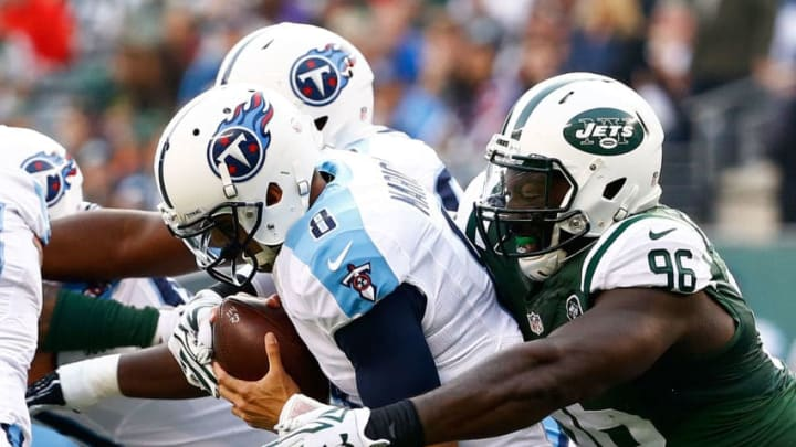 EAST RUTHERFORD, NJ - DECEMBER 13: Muhammad Wilkerson #96 of the New York Jets sacks Marcus Mariota #8 of the Tennessee Titans in the second quarter during their game at MetLife Stadium on December 13, 2015 in East Rutherford, New Jersey. (Photo by Al Bello/Getty Images)