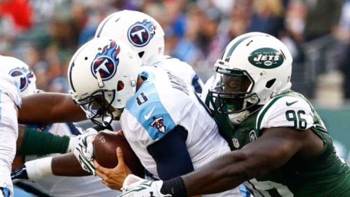 EAST RUTHERFORD, NJ – DECEMBER 13: Muhammad Wilkerson #96 of the New York Jets sacks Marcus Mariota #8 of the Tennessee Titans in the second quarter during their game at MetLife Stadium on December 13, 2015 in East Rutherford, New Jersey. (Photo by Al Bello/Getty Images)