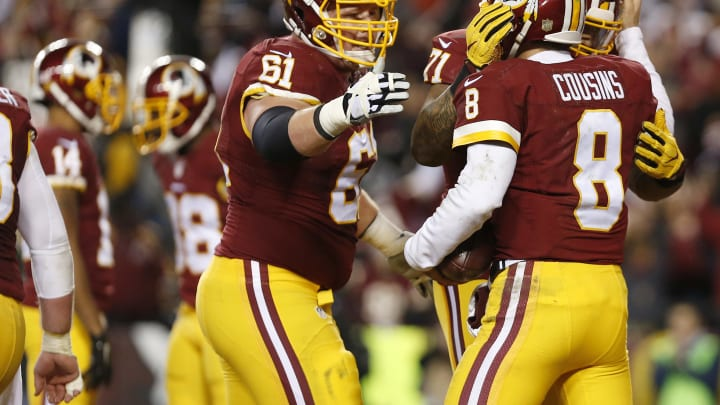LANDOVER, MD – JANUARY 10: Quarterback Kirk Cousins #8 of the Washington Redskins celebrates a third quarter touchdown with teammates tackle Trent Williams #71 and guard Spencer Long #61 against the Green Bay Packers during the NFC Wild Card Playoff game at FedExField on January 10, 2016 in Landover, Maryland. (Photo by Rob Carr/Getty Images)