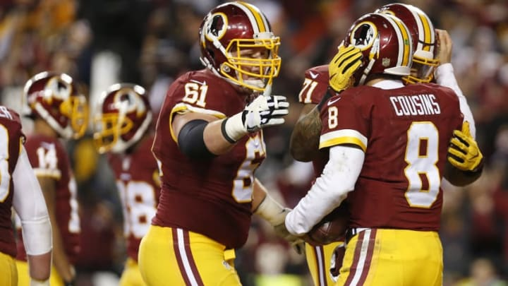 LANDOVER, MD - JANUARY 10: Quarterback Kirk Cousins #8 of the Washington Redskins celebrates a third quarter touchdown with teammates tackle Trent Williams #71 and guard Spencer Long #61 against the Green Bay Packers during the NFC Wild Card Playoff game at FedExField on January 10, 2016 in Landover, Maryland. (Photo by Rob Carr/Getty Images)