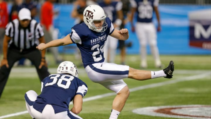 ST. PETERSBURG, FL - JANUARY 23: Taylor Bertolet #24 from Texas A&M kicks a field goal with a hold from Drew Kaser #38 from Texas A&M playing on the West Team during the first half of the East West Shrine Game at Tropicana Field on January 23, 2016 in St. Petersburg, Florida. (Photo by Mike Carlson/Getty Images)