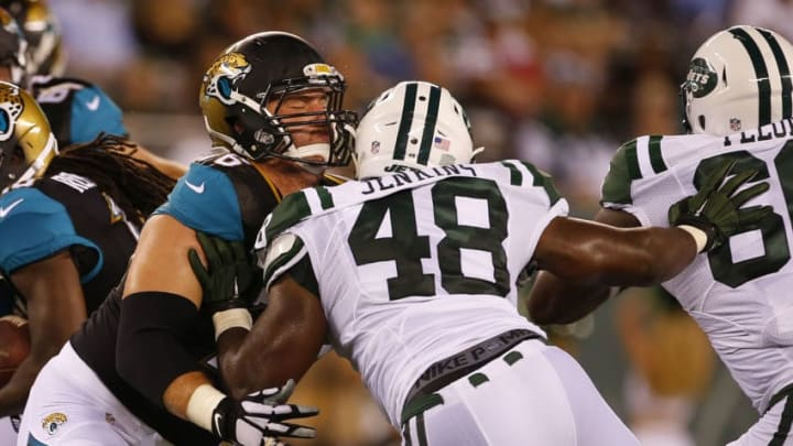 EAST RUTHERFORD, NJ - AUGUST 11: Luke Joeckel #76 of the Jacksonville Jaguars blocks Jordan Jenkins #48 of the New York Jets in an NFL preseason game at MetLife Stadium on August 11, 2016 in East Rutherford, New Jersey. (Photo by Rich Schultz/Getty Images)