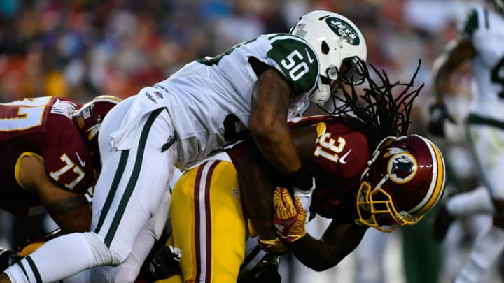 LANDOVER, MD - AUGUST 19: Running back Matt Jones #31 of the Washington Redskins runs the ball against outside linebacker Darron Lee #50 of the New York Jets during the first half at FedExField on August 19, 2016 in Landover, Maryland. (Photo by Larry French/Getty Images)