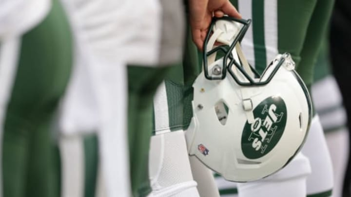 KANSAS CITY, MO – SEPTEMBER 25: A New York Jets helmet is held behind a player's back during the national anthem before NFL action against the Kansas City Chiefs at Arrowhead Stadium before the game on September 25, 2016 in Kansas City, Missouri. (Photo by Jamie Squire/Getty Images)