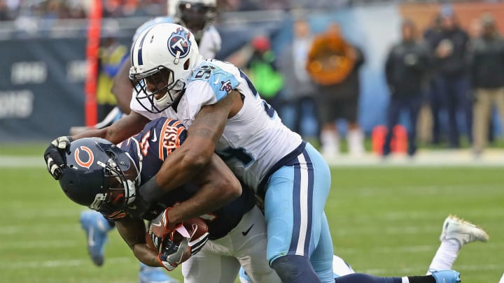 CHICAGO, IL – NOVEMBER 27: Josh Bellamy #11 of the Chicago Bears is dropped by Avery Williamson #54 of the Tennessee Titans after making a catch at Soldier Field on November 27, 2016 in Chicago, Illinois. The Titans defeated the Bears 27-21. (Photo by Jonathan Daniel/Getty Images)
