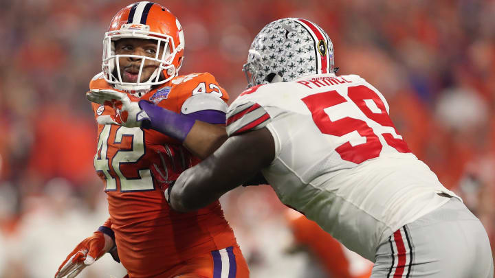 GLENDALE, AZ – DECEMBER 31: Defensive lineman Christian Wilkins #42 (L) of the Clemson Tigers in action against offensive lineman Isaiah Prince #59 of the Ohio State Buckeyes during the Playstation Fiesta Bowl at University of Phoenix Stadium on December 31, 2016 in Glendale, Arizona. The Tigers defeated the Buckeyes 31-0. (Photo by Christian Petersen/Getty Images)
