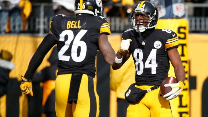 PITTSBURGH, PA - JANUARY 08: Antonio Brown #84 of the Pittsburgh Steelers celebrates his touchdown with Le'Veon Bell #26 in the first quarter during the Wild Card Playoff game against the Miami Dolphins at Heinz Field on January 8, 2017 in Pittsburgh, Pennsylvania. (Photo by Justin K. Aller/Getty Images)