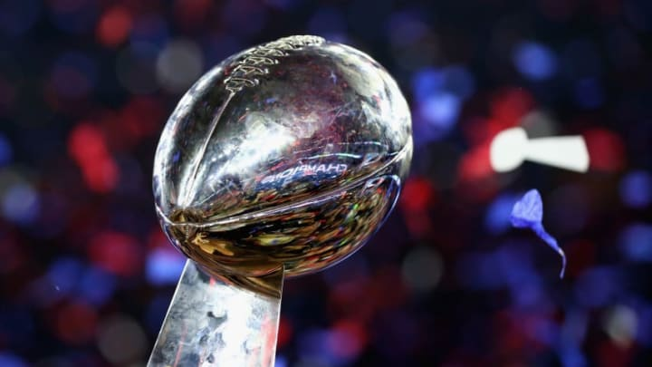 HOUSTON, TX - FEBRUARY 05: The New England Patriots celebrate with the Vince Lombardi Trophy after defeating the Atlanta Falcons during Super Bowl 51 at NRG Stadium on February 5, 2017 in Houston, Texas. The Patriots defeated the Falcons 34-28. (Photo by Al Bello/Getty Images)