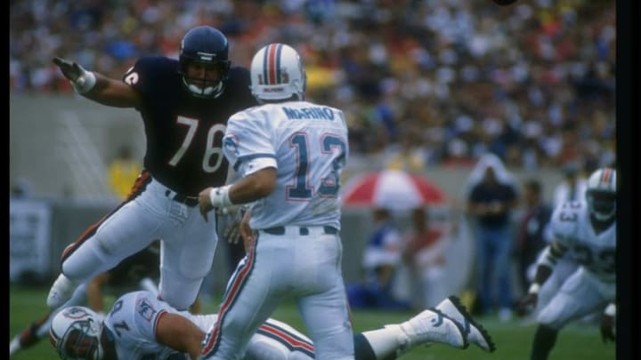 4 Sep 1988: Defensive lineman Steve McMichael of the Chicago Bears (left) goes after Miami Dolphins quarterback Dan Marino during a game at Soldier Field in Chicago, Illinois. The Bears won the game, 34-7.