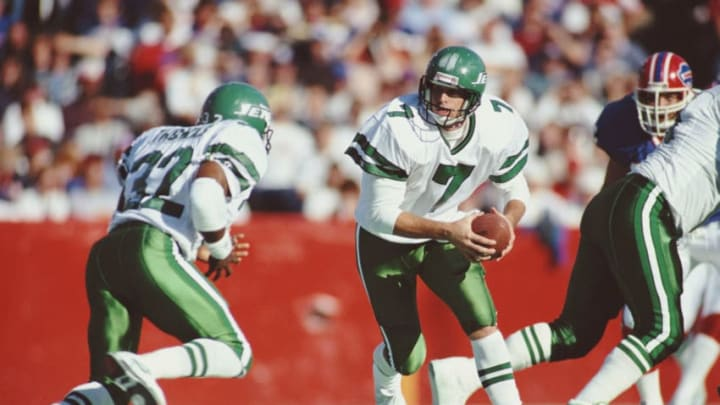 Ken O'Brien #7, Quarterback for the New York Jets carries the ball out to his Running Back #27 Blair Thomas during their American Football Conference East game on 21 October 1990 at Rich Stadium, Orchard Park, New York, United States. The Bills won the game 30 - 27. (Photo by Jim Rick Stewart/Allsport/Getty Images)
