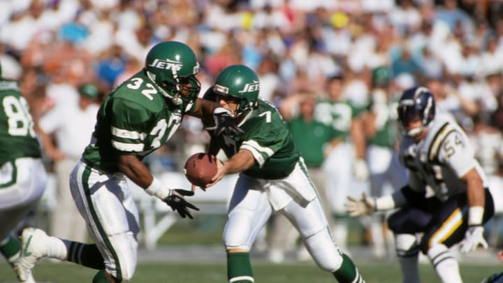 SAN DIEGO, CA – DECEMBER 2: Running back Blair Thomas #32 of the New York Jets attempts to secure a hand off from quarterback Jack O'Brien #7 during a game against the San Diego Chargers at Jack Murphy Stadium on December 2, 1990 in San Diego, California. The San Diego Chargers won 38-17 (Photo by George Rose/Getty Images)