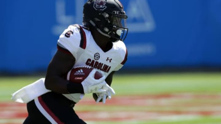CHARLOTTE, NC – SEPTEMBER 02: Deebo Samuel #1 of the South Carolina Gamecocks runs back the opening kickoff for a touchdown against the North Carolina State Wolfpack during their game at Bank of America Stadium on September 2, 2017 in Charlotte, North Carolina. (Photo by Streeter Lecka/Getty Images)