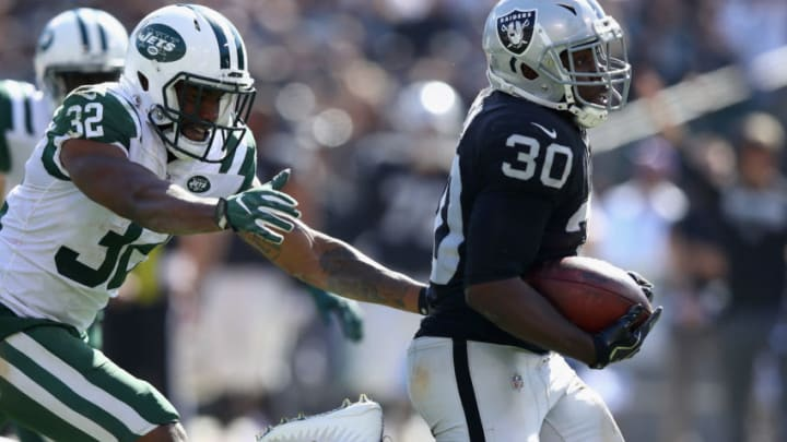 OAKLAND, CA - SEPTEMBER 17: Jalen Richard #30 of the Oakland Raiders breaks free from Juston Burris #32 of the New York Jets on his way to scoring a touchdown at Oakland-Alameda County Coliseum on September 17, 2017 in Oakland, California. (Photo by Ezra Shaw/Getty Images)