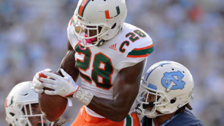 CHAPEL HILL, NC – OCTOBER 28: Michael Jackson #28 of the Miami Hurricanes intercepts a pass intended for Anthony Ratliff-Williams #17 of the North Carolina Tar Heels during their game at Kenan Stadium on October 28, 2017 in Chapel Hill, North Carolina. Miami won 24-19. (Photo by Grant Halverson/Getty Images)