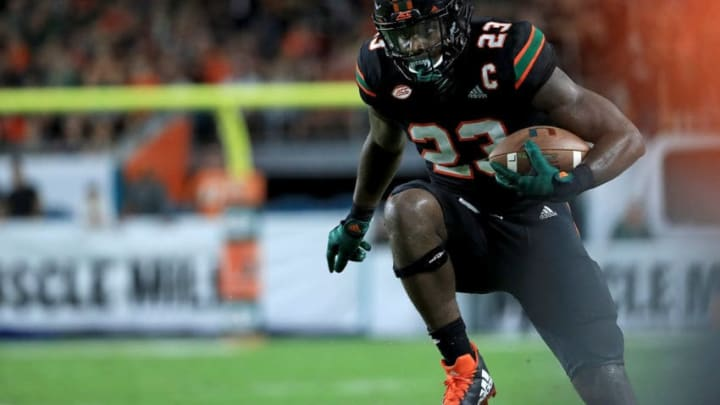 MIAMI GARDENS, FL - NOVEMBER 04: Christopher Herndon IV #23 of the Miami Hurricanes rushes for a touchdown during a game against the Virginia Tech Hokies at Hard Rock Stadium on November 4, 2017 in Miami Gardens, Florida. (Photo by Mike Ehrmann/Getty Images)