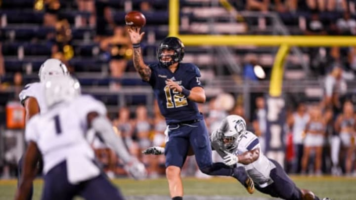 MIAMI, FL – NOVEMBER 11: Quarterback Alex McGough #12 of the FIU Panthers is pressured buy defensive end Oshane Ximines #7 of the Old Dominion Monarchs during the first half of the game at Riccardo Silva Stadium on November 11, 2017 in Miami, Florida. (Photo by Rob Foldy/Getty Images)