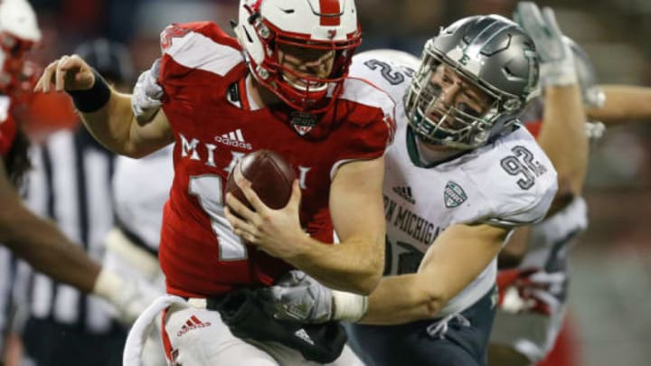 OXFORD, OH – NOVEMBER 15: Maxx Crosby #92 of the Eastern Michigan Eagles sacks Gus Ragland #14 of the Miami Ohio Redhawks during the second half at Yager Stadium on November 15, 2017 in Oxford, Ohio. (Photo by Michael Reaves/Getty Images)