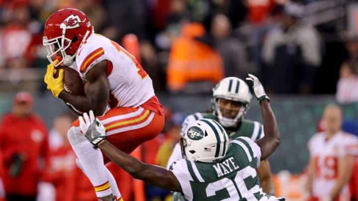 EAST RUTHERFORD, NEW JERSEY - DECEMBER 03: Tyreek Hill #10 of the Kansas City Chiefs makes a catch in the final minutes of the game as Marcus Maye #26 of the New York Jets defends on December 03, 2017 at MetLife Stadium in East Rutherford, New Jersey.The New York Jets defeated the Kansas City Chiefs 38-31. (Photo by Elsa/Getty Images)