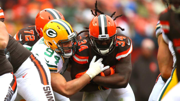 CLEVELAND, OH – DECEMBER 10: Dean Lowry #94 of the Green Bay Packers tackles Isaiah Crowell #34 of the Cleveland Browns in the first quarter at FirstEnergy Stadium on December 10, 2017 in Cleveland, Ohio. (Photo by Gregory Shamus/Getty Images)