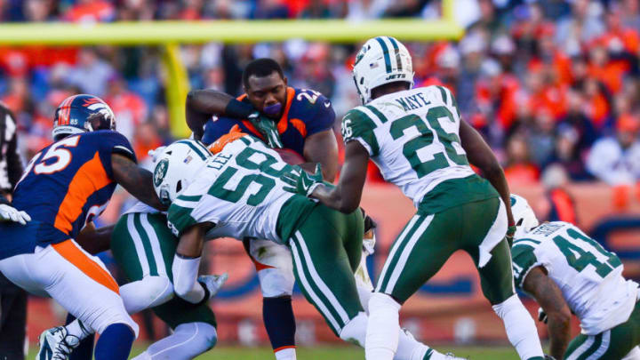 DENVER, CO - DECEMBER 10: Running back C.J. Anderson #22 of the Denver Broncos loses his helmet as he is hit by inside linebacker Darron Lee #58 of the New York Jets during a game at Sports Authority Field at Mile High on December 10, 2017 in Denver, Colorado. (Photo by Dustin Bradford/Getty Images)